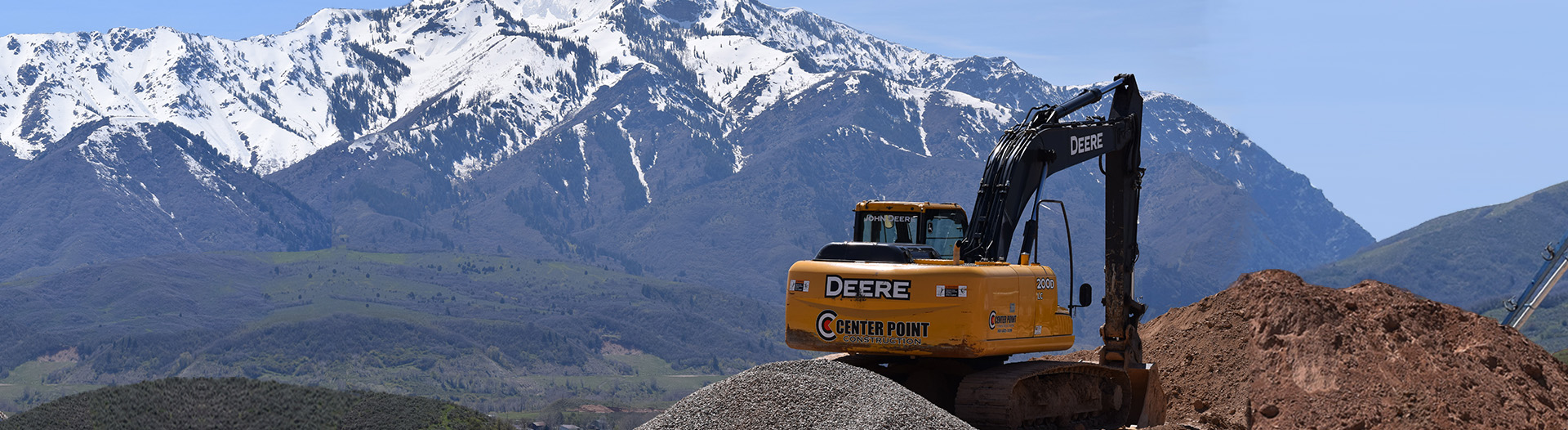 Center Point Construction trackhoe working in the mountains in Northern Utah