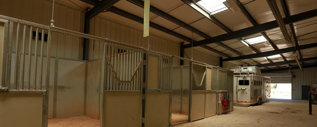 horse stables located inside custom built horse arena